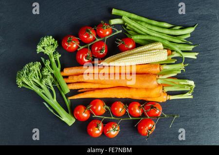 Fresh vegetables on a slate, organic food, flat lay - Stock Photo