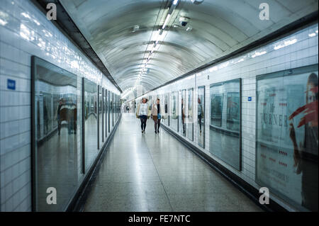 London Underground tunnel and passengers - Stock Photo