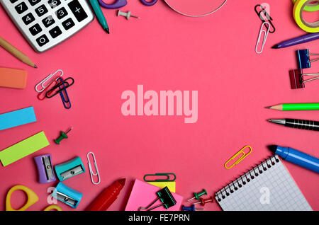 School and office supplies on pink background - Stock Photo