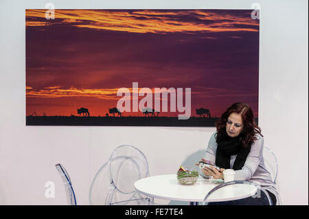 London, UK.  4 February 2016. A visitor to the opening day of 'Destinations: The Holiday & Travel Show' at Olympia - Stock Photo