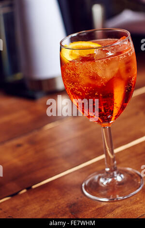 A glass of aperol spritz in a bar - Stock Photo