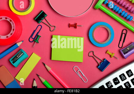Office and school supplies on pink background - Stock Photo