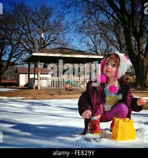 Cute Little Girl Playing In Snow - Stock Photo