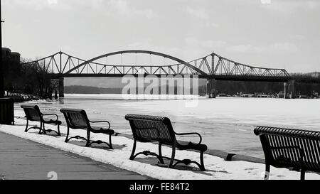 Empty Benches Overlooking Calm River - Stock Photo