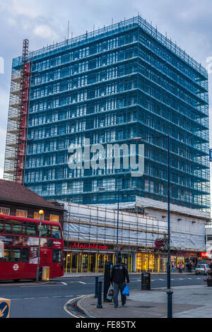 Scaffolding netting on building, Edgware, Greater London, England, UK. - Stock Photo