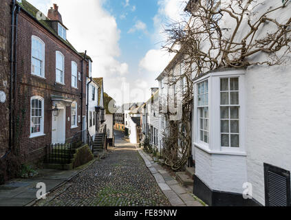 Looking down the cobbled Mermaid Street in Rye, East Sussex, towards Strand Quay and the Heritage Centre.