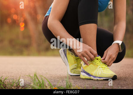 woman tying sport shoes ready for run - Stock Photo