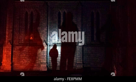 Man Figure Casting Shadow On Church Wall - Stock Photo