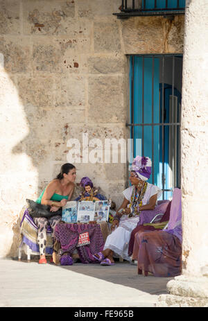 One of the fortune tellers who casts cards for tourists in Old Havana - Stock Photo