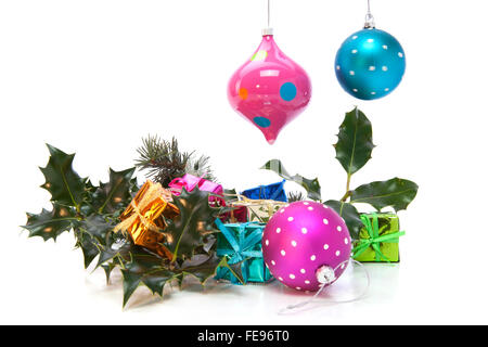 Christmas Decorations with Holly, Balls and Gifts - Stock Photo