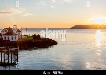 Mukilteo lighthouse and Puget Sound at sunset with Whidbey Island in the distance, Washington State. Beautiful Pacific - Stock Photo