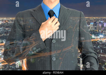 Double exposure of young businessman and beautiful night city background. - Stock Photo