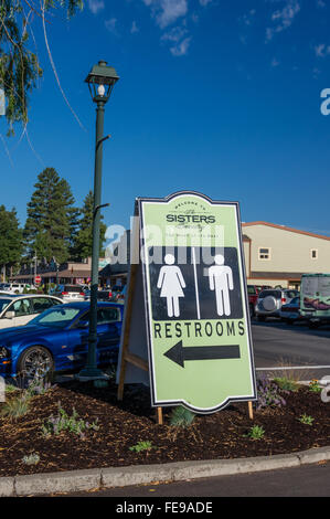 Restroom directional sign at the Sisters Outdoor Quilt Show, SIsters, Oregon - Stock Photo