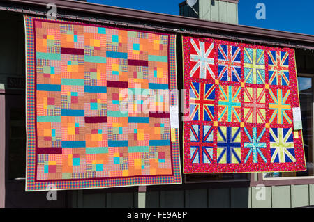 Quilts on display at the Sisters Outdoor Quilt Show, SIsters, Oregon - Stock Photo