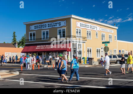 Tourists crossing the street at the Sisters Outdoor Quilt Show, SIsters, Oregon - Stock Photo