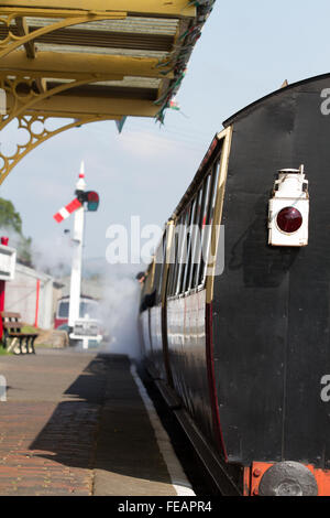 Bala Departure, in bright sunshine a train leaves the station on the Bala Lake Railway, focus on the tail lamp at - Stock Photo