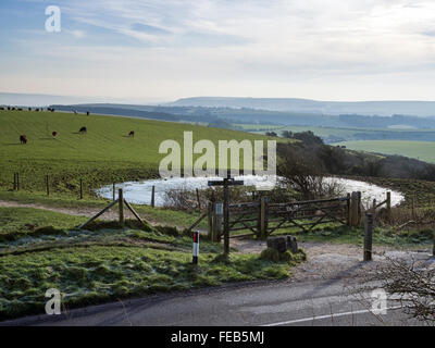 A misty view south east from Ditchling Beacon across the South Downs near Brighton, Sussex Stock Photo