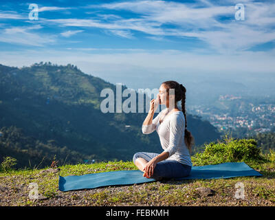 young woman in lotus asana position meditation and