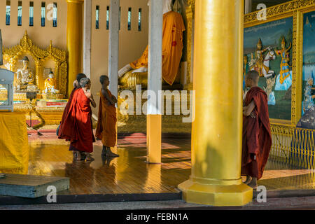 Monks at the Shwedagon pagoda. Rangoon, Burma - Stock Photo