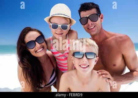 Cute family wearing sunglasses - Stock Photo