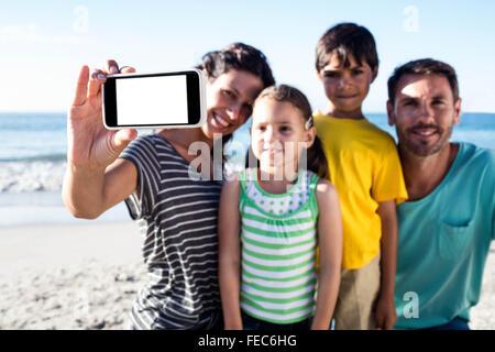 Cute family taking selfie - Stock Photo