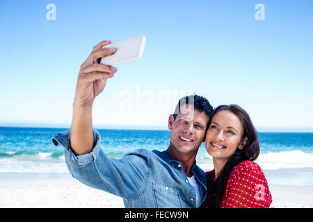 Cute couple taking a selfie - Stock Photo