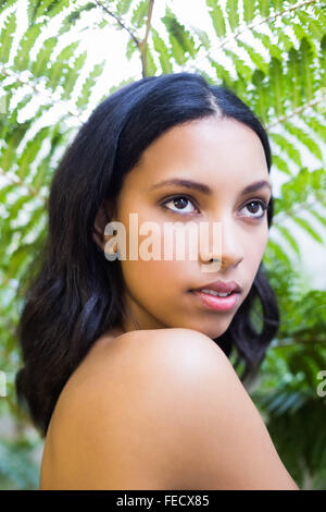 Portrait of a pretty woman staring - Stock Photo