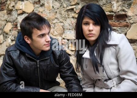 Affectionate teenage couple - Stock Photo
