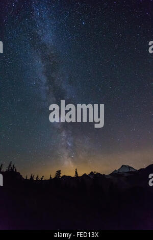 Milky Way over Mount Baker, viewed from Chain Lakes Loop Trail, Mt. Baker–Snoqualmie National Forest, Washington - Stock Photo
