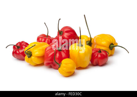 Fresh yellow and red Scotch bonnet chili peppers on white background - Stock Photo