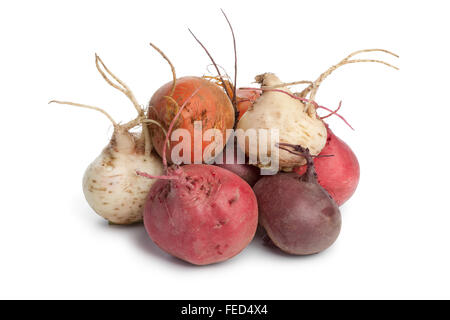 Fresh mixed heirloom color beets on white background - Stock Photo