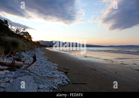 Sunset on the beach of the Marlborough Sounds New Zealand - Stock Photo