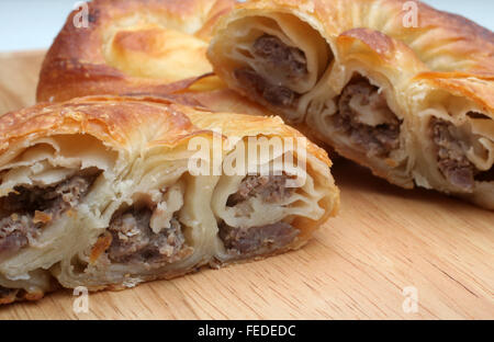 Burek (pie with meat, cheese or spinach) is traditional Balkan meal - Stock Photo