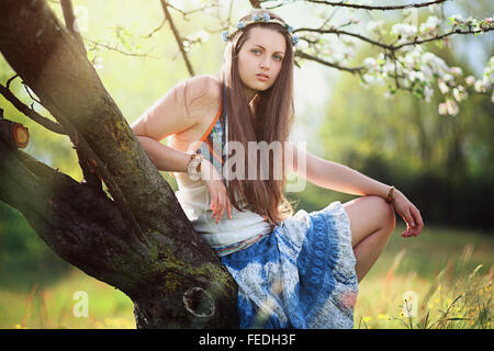 Romantic woman in flower meadow . Hippie and gypsy dress - Stock Photo