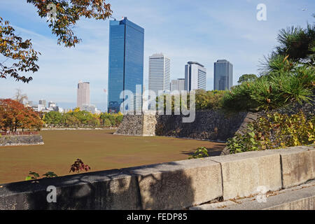 The moat around Osaka-jo castle,  with Osaka's skyscrapers behind, Japan - Stock Photo