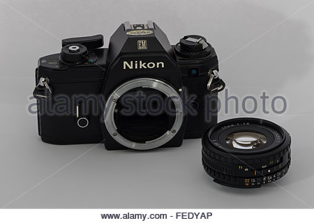 A Nikon EM 35mm SLR film SLR camera with a 50mm f1.8 'E-Series' lens. An entry-level SLR made in Japan circa 1980. - Stock Photo