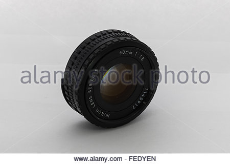 A Nikon 50mm f1.8 'E-Series' lens. Made for their entry-level Nikon EM SLR camera in Japan circa 1980. - Stock Photo