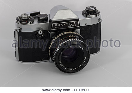 A Praktica Nova 1 a 35mm SLR film camera with a 1.8/50 Meyer-Optik Oreston lens.A 1970's entry-level SLR made in - Stock Photo