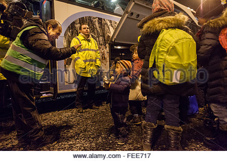 refugees arrive at Cologne airport train station on a special train from german border town Passau to start the - Stock Photo