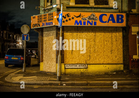Abandoned Mini-Cab, urban decay at night,  Harringay, London - Stock Photo