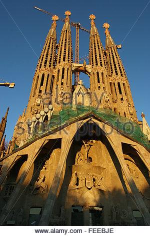 Front exterior Segrada Familia temple with construction cranes. The Basílica i Temple Expiatori de la Sagrada Família, - Stock Photo