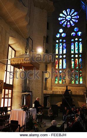 Private religious service in Segrada Familia temple. Interior of Basílica i Temple Expiatori de la Sagrada Família, - Stock Photo