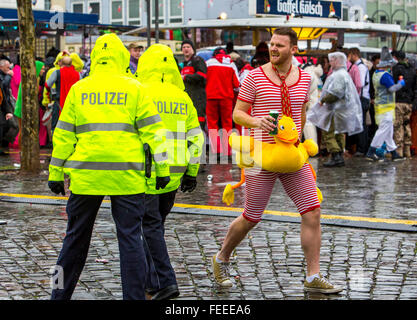 Police on duty during street carnival party in Cologne, Germany, on Shrove Thursday, - Stock Photo