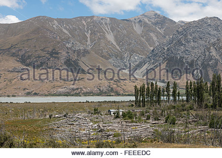 Abandoned hut on a shore of mountain river, New Zealand - Stock Photo