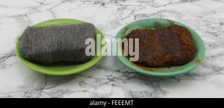 Two steel wool. The left is dried and the right is wet. The wet steel wool shows after a while with rusty appearance. - Stock Photo