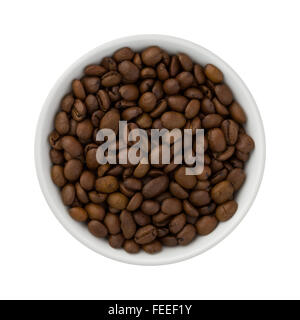 Coffee Beans in a Ceramic Bowl. The image is a cut out, isolated on a white background. - Stock Photo