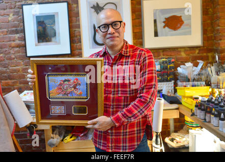(160205) -- NEW YORK, Feb. 5, 2016 (Xinhua) -- Kam Mak shows the Year of the Dragon Stamp designed by himself in - Stock Photo