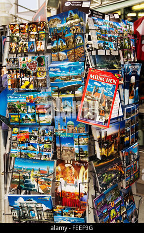 MUNICH - APRIL 17, 2014: Postcards stand with main city landmarks. On sale outside a shop in Munich, Germany. - Stock Photo