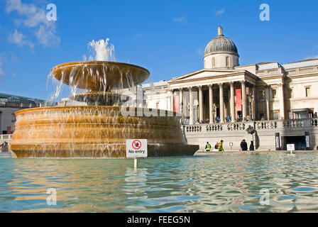 Fountain outside the National Gallery in Trafalgar Square in central London - Stock Photo