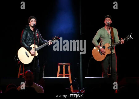 PATCHOGUE, NY-FEB 3: Musicians Stephen Barker Liles (L) and Eric Gunderson of Love and Theft perform onstage at - Stock Photo